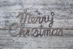 Le Joyeux Noël se connectent le fond en bois de vintage Photographie stock libre de droits