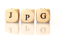 Le JPG a orthographié le mot, lettres de matrices avec la réflexion Photo libre de droits