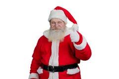 Le jultomten som ger upp tummen Royaltyfria Bilder