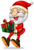 Le jultomten som rymmer en gåva för jul Royaltyfri Bild