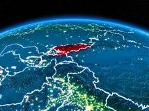 Le Kirghizistan de l'espace la nuit Photos stock