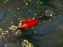 Le Kirghizistan en rouge la nuit Photo stock