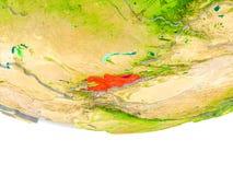 Le Kirghizistan en rouge sur le modèle de la terre Images libres de droits
