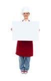 Le kock som visar det vita annonserande brädet Arkivbild