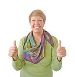 Le kvinna i grön visande tum upp Arkivfoto