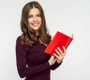 Le kvinnastudenten som rymmer den röda boken arkivfoto