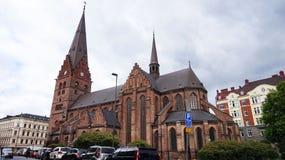Le kyrka de Sankt Pétri est une grande église dans Malmö qu'elle est construite dans le style gothique et a des 105 mètres tour  Images stock