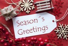 Le label avec la décoration de Noël, texte assaisonne des salutations Images stock
