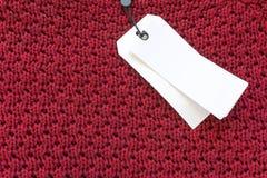 Le label de vente de prix à payer de Blanc sur le rouge a tricoté le Ba de texture de tissu de laine Images libres de droits