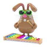le lapin de 3d Pâques joue le xylophone Photos stock