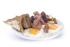 le lard eggs les pommes de terre rissolées et le pain grillé Image libre de droits