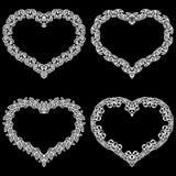 Le laser a coupé le cadre sous forme de coeur avec la frontière de dentelle Un ensemble des bases pour le napperon de papier pour Photographie stock