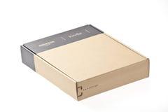 Le lecteur enfermé dans une boîte Amazone d'E-Livre allument 3 Photographie stock libre de droits