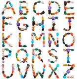Le lettere hanno ortografato con le pietre semipreziose Fotografie Stock