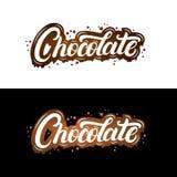Le lettrage écrit par main de chocolat avec éclabousse et tache Photos stock