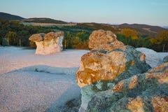 Le lever de soleil à un phénomène de roche la pierre répand, la Bulgarie Photographie stock libre de droits