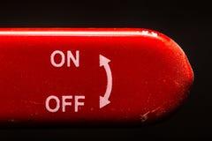 le levier rouge sur outre du fond d'obscurité de commutateur Images libres de droits