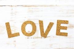 Le liège d'amour de mot sur le bois blanc Photographie stock