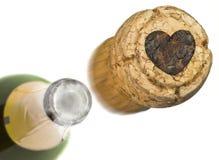 Le liège lancé de champagne avec la forme d'un coeur a brûlé dedans seri Images libres de droits