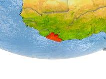 Le Libéria en rouge sur le modèle de la terre Photographie stock