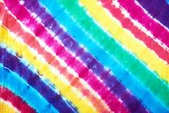 Le lien coloré a teint le modèle sur le tissu de coton pour le fond Photographie stock libre de droits