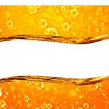 Le liquide coule les bulles d'air d'or et macro photo libre de droits