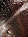Le liquide laisse tomber de macro beaux-arts de papier peint de fond photographie stock