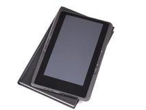 Le livre électronique et le livre de papier Photos stock
