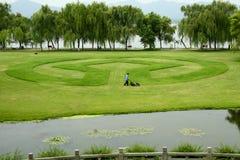 Le logo du patrimoine mondial apparaît dans la pelouse grande Image stock