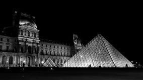 Le Louvre, Paris. Landscape : Louvre pyramid and architecture, Paris, by night Royalty Free Stock Image