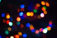 Le luci di Natale offuscano il fondo delle luci con una tonnellata di bokeh Fotografia Stock