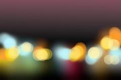 Le luci nell'ambito del bokeh del cielo di sera offusca il fondo Fotografie Stock