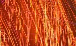 Le luci scintillanti dell'oro di scintillio arancio del fondo fanno festa la celebrazione di festa fotografia stock libera da diritti