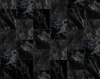 Le luxe du marbre noir couvre de tuiles la texture et le fond Images stock