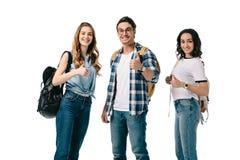 le mångkulturella studenter som visar upp tummar royaltyfria foton