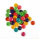 Le mélange de la couture colorée ronde se boutonne sur le blanc Photo libre de droits