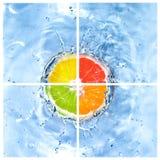 Le mélange du citron a chuté dans l'eau avec des bulles Photographie stock