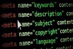 Le méta de code de programmation par ordinateur de page Web de HTML étiquette dans la lumière rouge et vert-foncé avec le pointeu image stock