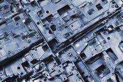 Le métal meurent des morceaux de fonte - fond industriel abstrait Photos stock