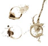 Le macchie del caffè hanno impostato isolato su bianco Fotografie Stock Libere da Diritti