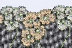Le macro tir des fleurs blanches et beiges lacent la texture Photographie stock libre de droits