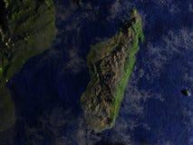 Le Madagascar la nuit sur le modèle réaliste de la terre Images stock