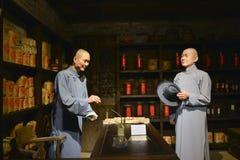 Le magasin antique de thé de la Chine, culture potable de la Chine, chiffre de cire d'intérieur du magasin de thé de la Chine, Photographie stock