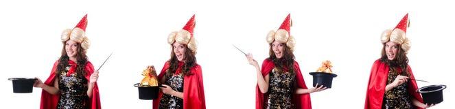 Le magicien féminin d'isolement sur le blanc Photo stock