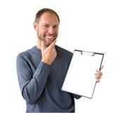 Le man i gray med en tablet Fotografering för Bildbyråer