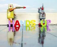 Le mani aumentano i robot Immagini Stock