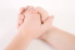 Le mani clasped Immagini Stock