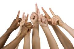 le mani del gruppo che tengono il numero uno firmano in su Fotografie Stock