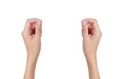 Le mani della donna che giudicano qualche cosa di vuoto Immagine Stock