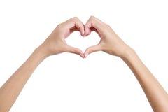 Le mani della donna che modellano un lato posteriore di simbolo del cuore, Fotografia Stock Libera da Diritti